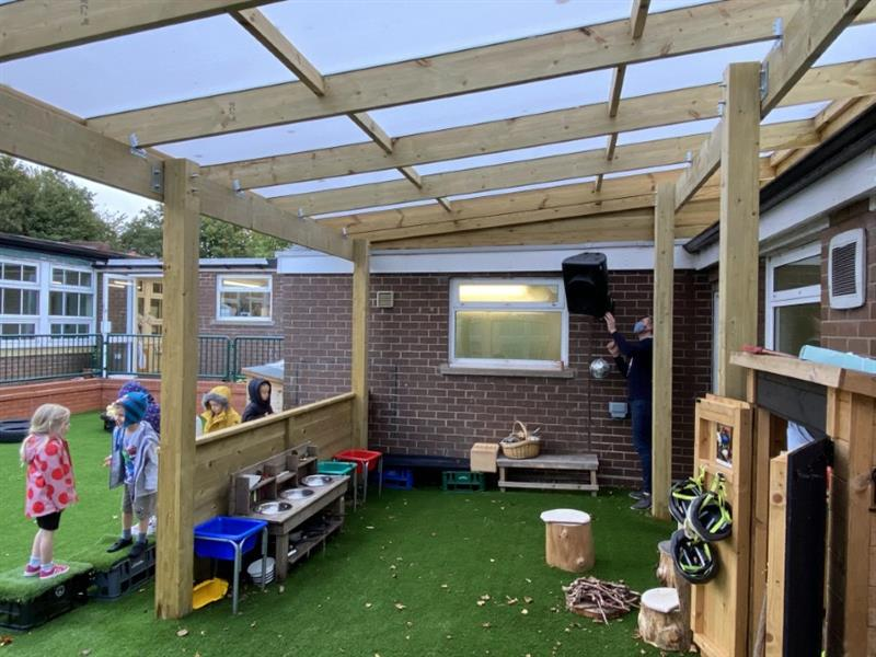 A water tight timber canopy adjacent to the classroom doors
