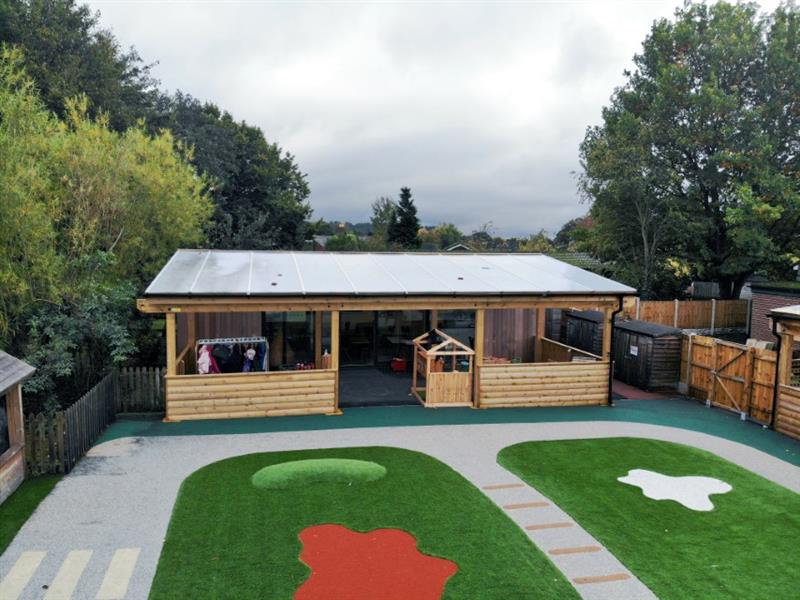 A school timber canopy providing a free flow play environment