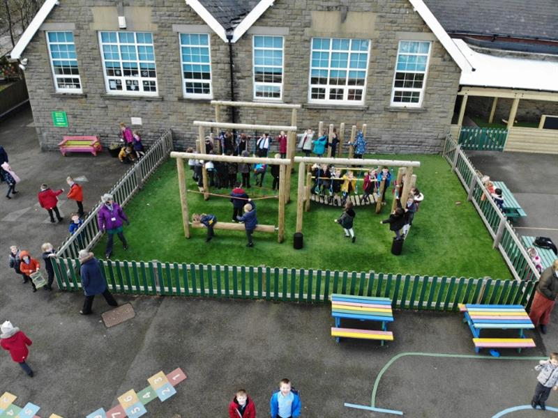 KS1 Children Playing On A Trim Trail