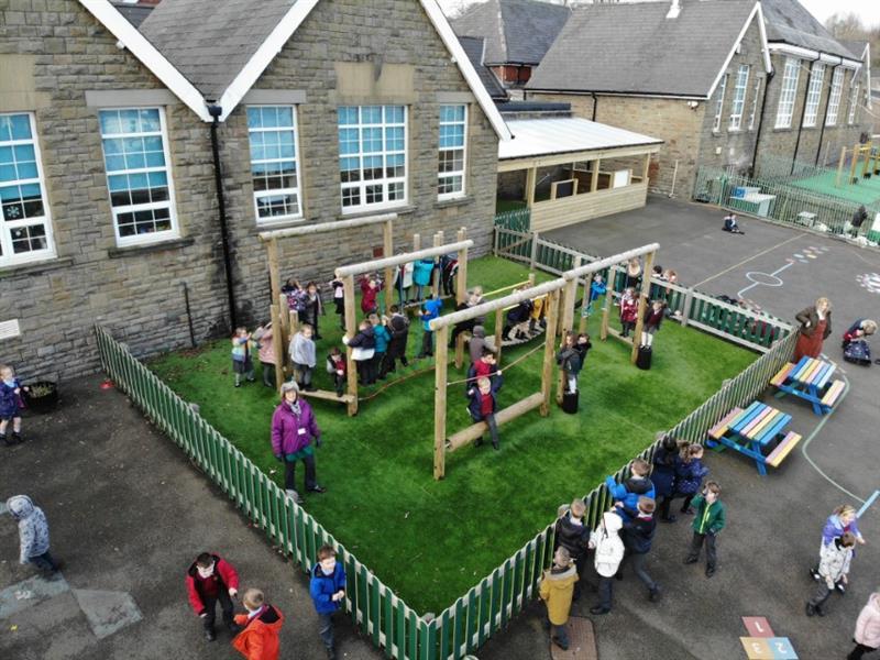 children enjoying the playground equipment installed by Pentagon Play