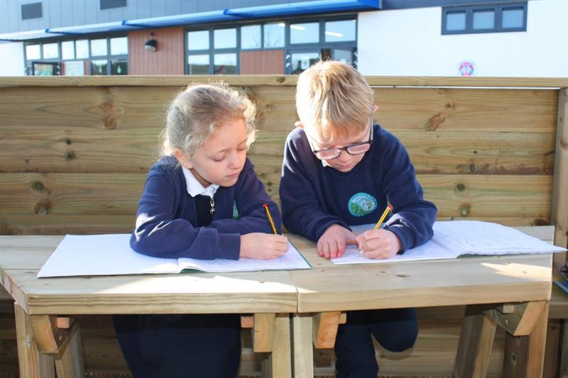 Children working on outdoor gazebo workstations