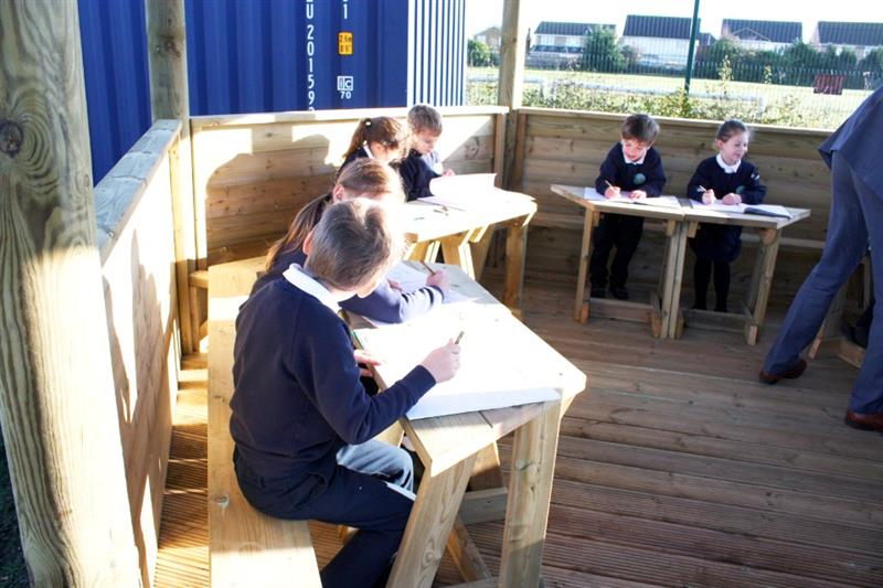 Children learning in an outdoor classroom
