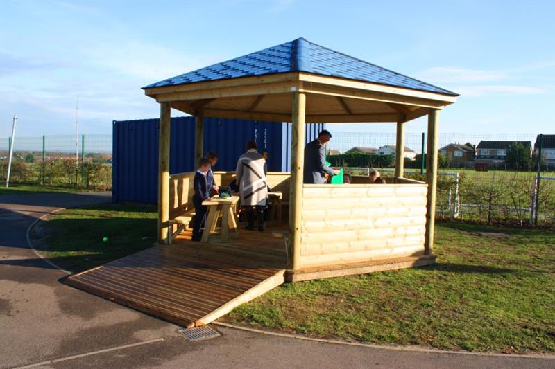 An outdoor classroom installed onto grass