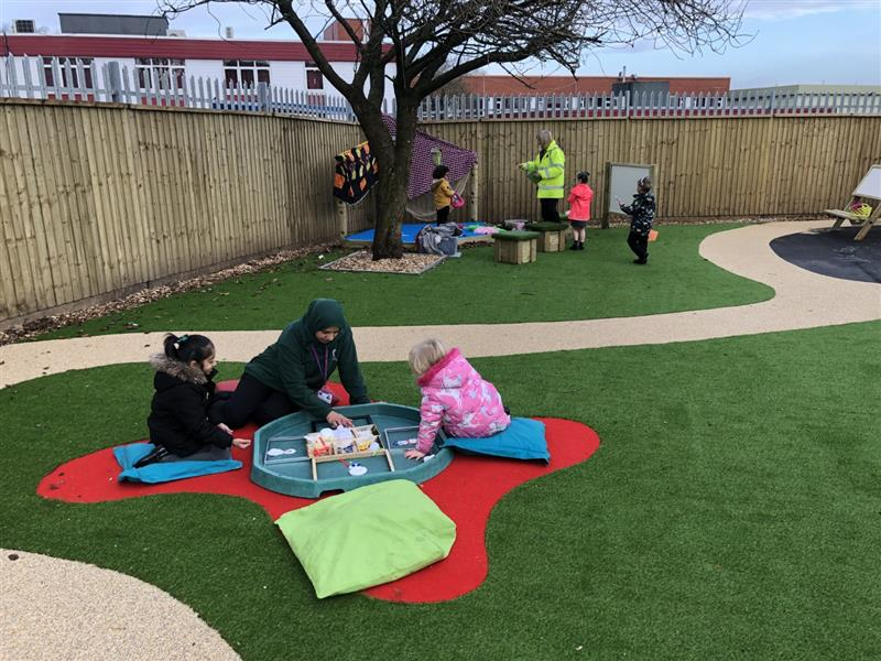 outdoor learning taking place on a pentagon playground
