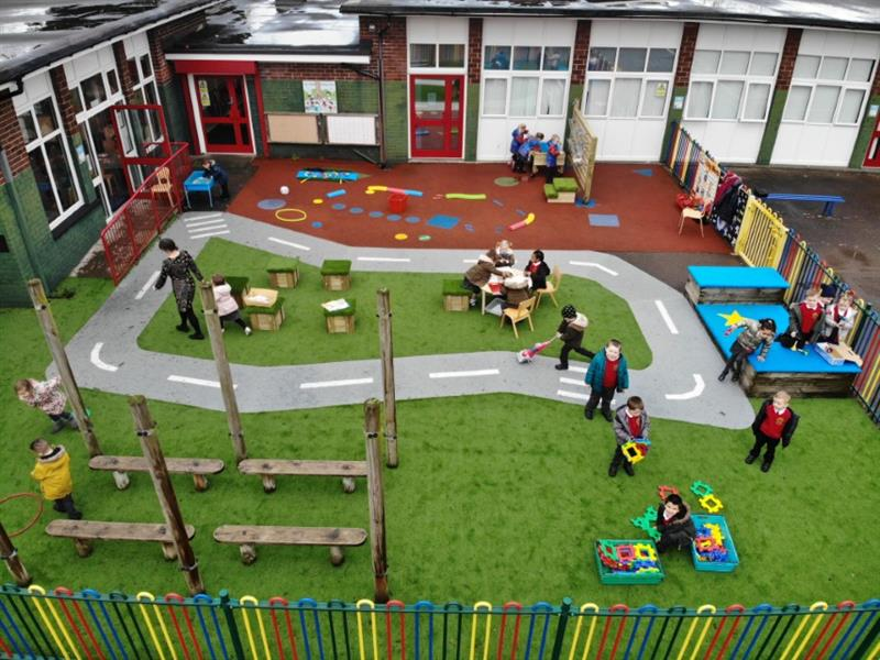Children playing on a Pentagon Play EYFS Playground