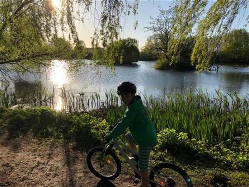 child outside on a bike exploring