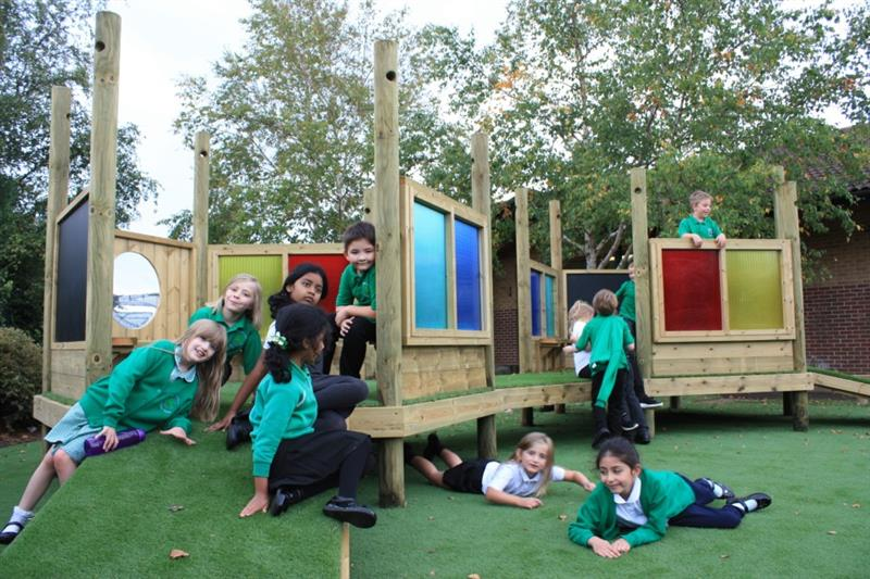Children playing together on Pentagon Play's Imagination Station