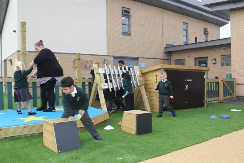 Children playing outdoor musical instruments