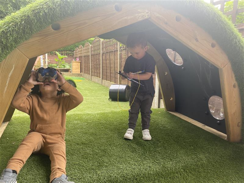 children playing in their new EYFS area