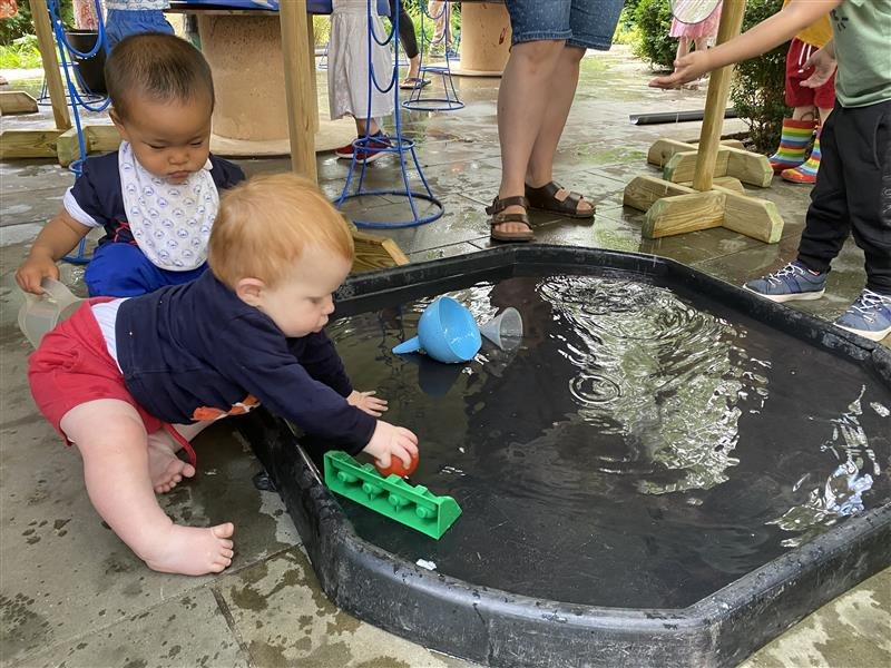 children playing on the water mat