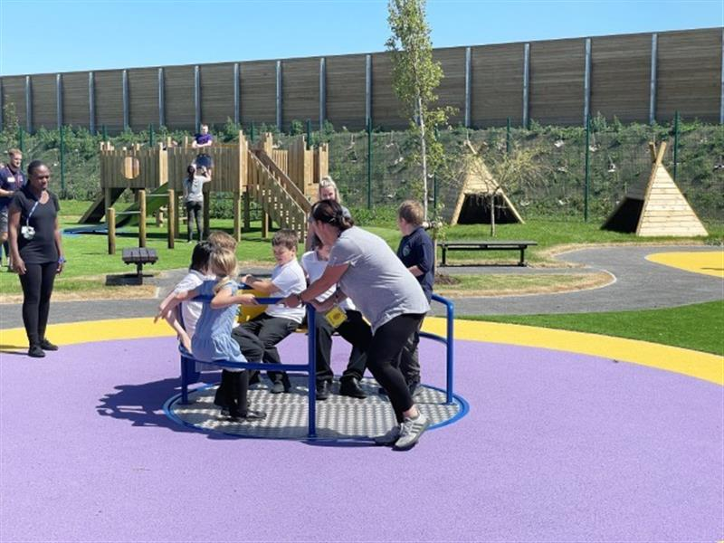 A picture of children on a roundabout