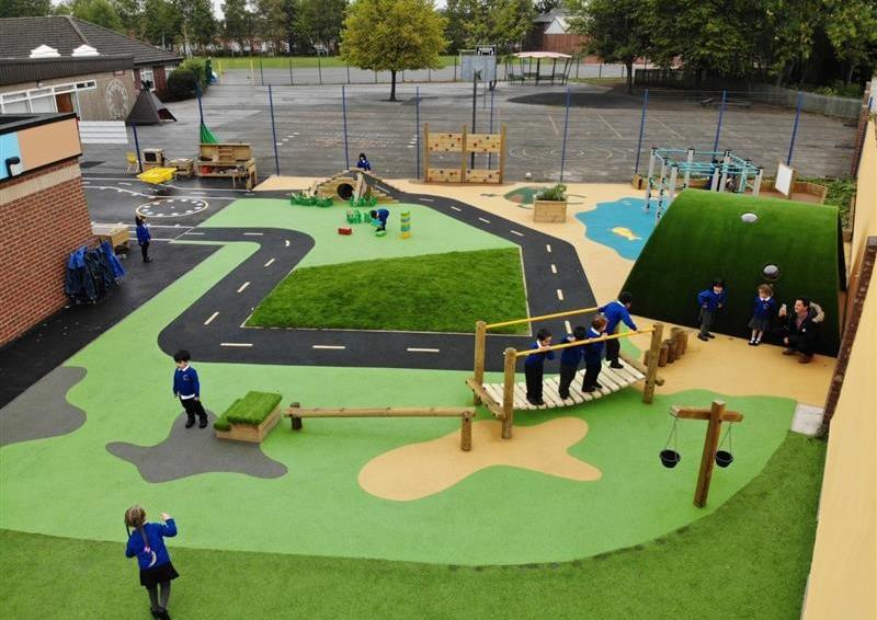 Outdoor play area surfacing