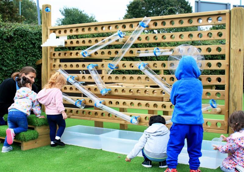 Water play playground equipment